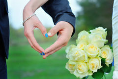 Two hands form a heart shape with their fingers Stock Images