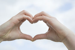 Two Hands Forming a Heart Stock Photography