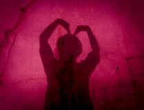 Two hands forming a heart shadow on the wall in the cave Royalty Free Stock Images