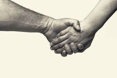 Two hands - friendship Stock Photos