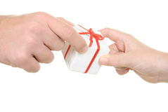 Two hands and gift. On  white background Stock Image