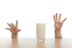 Two hands and glass of milk Royalty Free Stock Photo