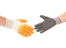 Two hands gloves meet in hand shake. Stock Image