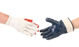 Two hands gloves meet in hand shake. Royalty Free Stock Photography