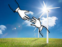 Two hands graphic on bright countryside with wind turbines Royalty Free Stock Photos
