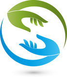 Two hands in green and blue, massage and orthopedic logo Stock Photos