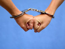 Two hands in handcuffs Royalty Free Stock Images