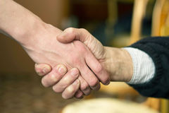 Handshake. Two hands in a handshake Stock Photo
