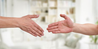 Two hands before handshake Stock Photography