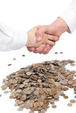 Two hands in a handshake and money. Two hands in a handshake and a money isolated on white Royalty Free Stock Photo