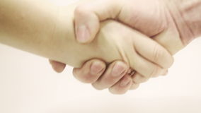 Two hands are handshaking. They are a lady and a man with rings on their fingers stock video