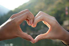 Two hands in heart shape. Two hands from two person become one heart shape Stock Image