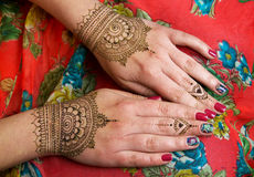 Two hands with henna tattoos mehendi designs. Two hands with brown henna tattoos mehendi designs royalty free stock images