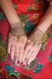 Two hands with henna tattoos mehendi designs. Two hands with brown henna tattoos mehendi designs royalty free stock photos