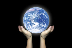 Two Hands hold the beautiful shining earth. Royalty Free Stock Photo