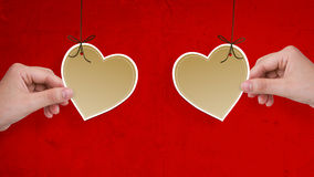 Two hands hold heart paper Stock Image