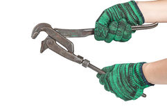 Two hands holding the adjust spanner on white background. indust Royalty Free Stock Image