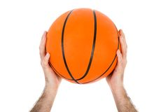 Two hands holding a basketball over white Royalty Free Stock Image