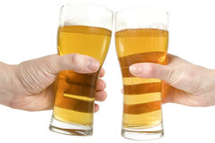 Two hands holding beers making a toast Stock Image