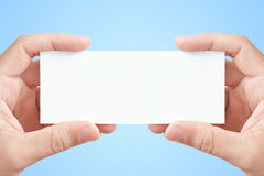 Two hands holding blank paper card Royalty Free Stock Photo