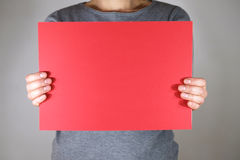 Two hands holding blank red paper sheet. Two hands holding blank red papersheet stock images