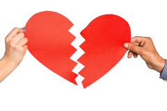 Two hands holding broken heart Stock Images
