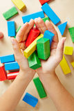 Two hands holding building blocks Stock Photography