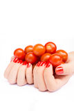 Two hands holding cherry tomatoes Royalty Free Stock Photography