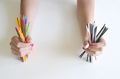 Two hands holding color sticks Royalty Free Stock Images
