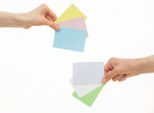 Two hands holding colorful paper cards Stock Image