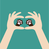 Two hands holding cute cat dog paw print. Love and care pet animals. Helping hand concept. Adopt, donate. Flat design.. Background. Template. Vector Stock Photography