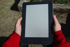 Two hands holding the e-book Stock Photography