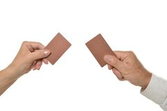 Two hands holding empty blank cards isolated Stock Images