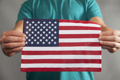Two Hands Holding Flag Stock Photography