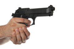 Two hands holding a gun with finger on the trigger Stock Photography
