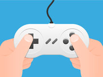 Two hands holding a joypad Stock Images