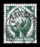 Two hands holding a piece of coal with inscription. MOSCOW, RUSSIA - FEBRUARY 9, 2019: A stamp printed in German Realm shows Two hands holding a piece of coal royalty free illustration