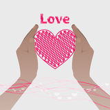 Two hands holding a pink heart with the line Royalty Free Stock Images