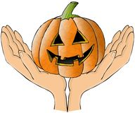 Two hands holding a pumpkin Stock Image