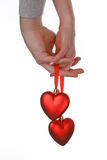 Two hands holding red hearts. Two human hands holding red hearts isolated on white background Royalty Free Stock Photos