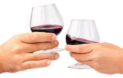 Two hands holding red wine glasses Royalty Free Stock Image