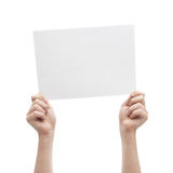 Two hands holding A4 sheet of paper Stock Image