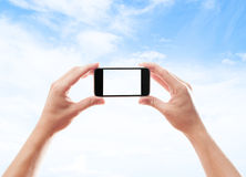 Two hands holding smart phone Stock Photography