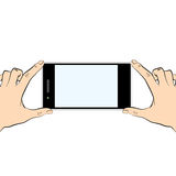 Two hands holding a smart phone Stock Photo