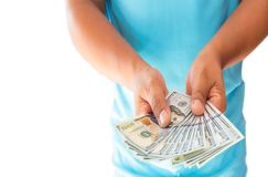 Two hands holding US dollar bills isolated on white background. Two hands holding US dollar bills isolated on blue shirt Stock Photos