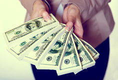 Two hands holding US dollar. Two woman hands holding US dollar Royalty Free Stock Images