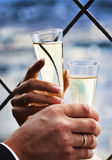 Two hands holding wedding champagne Stock Photography