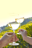 Two hands holding wineglases Royalty Free Stock Photography