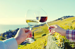 Two hands holding wineglases Stock Photo