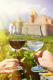 Two hands holding wineglasses Stock Photos